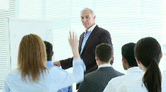 Busineswoman asking a question in a presentation Stock Footage