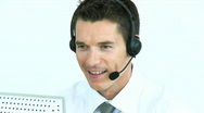 Businessman with a headset on working in a call center Stock Footage