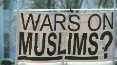 "Protest Banner: ""WARS ON MUSLIMS?"" - stock footage"
