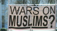 "Stock Video Footage of Protest Banner: ""WARS ON MUSLIMS?"""
