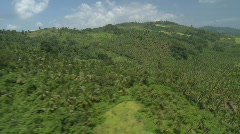 Aerial over a Mountain Range covered in Rain Forest - stock footage