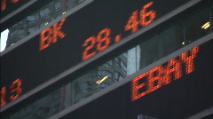 NYSE ticker tape rack focus Stock Footage