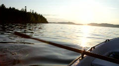 Rowing a boat on a fjord of the Baltic Sea in Sweden Stock Footage