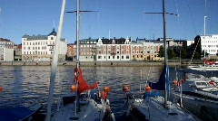 A sailing yacht leaves a marina in Sweden Stock Footage