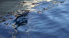 Reflection of a sailing boat in the waters of a marina Stock Footage