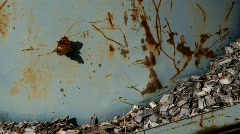 A butterfly is sitting on a metal container on a farm, enjoying the first warm d Stock Footage