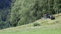 Tractor mowing a meadow on a fair summer day. Stock Footage