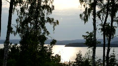 The low sun of a Swedish summer night plays on the ripples on a bay of the Balti Stock Footage