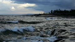 Waves rolling in at the coast of the Baltic Sea on a summer evening in Sweden. - stock footage