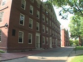 Stock Video Footage of Students ride bicycles in front of a Harvard classroom building.