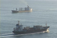 Cargo ships pass on the ocean. Stock Footage