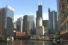 """The L"""" train runs along the tracks in front of the Chicago skyline."""" Stock Footage"""