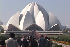 Pedestrians walk to the Baha'i Temple in New Delhi, India. Stock Footage
