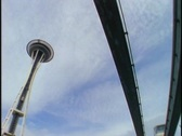 Stock Video Footage of A monorail drives past the Seattle Space Needle.