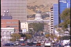 Traffic drives through downtown Salt Lake City. Stock Footage