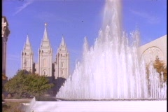 A fountain sprays near the Mormon Temple in Salt Lake City, Utah. Stock Footage