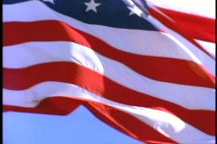 An American flag flies in the wind. Stock Footage