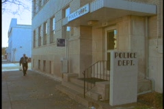An officer walks into a police station. Stock Footage