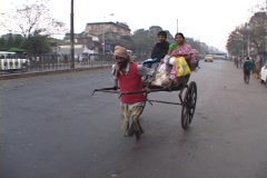 A man pulls a rickshaw on the streets of Calcutta, India. Stock Footage