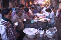 People buy food from vendors in an open air market in Calcutta, India. Stock Footage