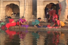 Women wash clothes in the Ganges River. Stock Footage