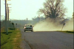 A pickup truck drives down a dirt road. - stock footage