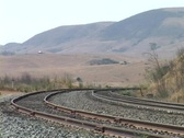 The Amtrak passenger train travels along a track. Stock Footage