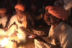 An Indian mystic eats fire at festival in Rajasthan, India Stock Footage