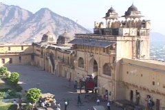 An elephant and riders enter palace gates in Rajasthan, India. Stock Footage