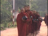 Buddhist monks collect alms in the morning. Stock Footage