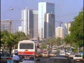 Skyscrapers tower over a busy street in Tel Aviv. Stock Footage