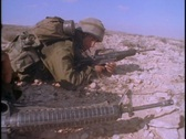 Soldiers train in the desert with guns. Stock Footage