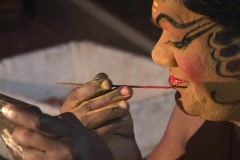 An actor applies his makeup for a Kathakali Dance performance. Stock Footage