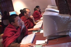 A group of Buddhist monks work on computers. Stock Footage