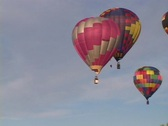 Colorful hot air balloons float through the sky. Stock Footage