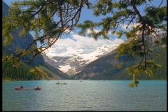 Mountains surround Lake Louise. Stock Footage