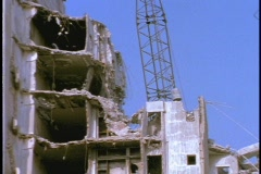 A wrecking ball hits a dilapidated building causing it to collapse. - stock footage