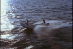A small motorboat speeds across the water. Stock Footage