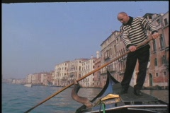 A man rows a gondola in Venice. Stock Footage