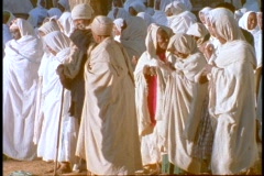 Ethiopian Coptic priests and other worshipers pray near a sacred church in Axum, Stock Footage