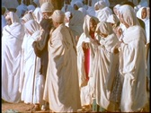 Stock Video Footage of Ethiopian Coptic priests and other worshipers pray near a sacred church in Axum,