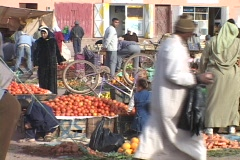 A crowd of people shop at an Moroccan outdoor market. Stock Footage
