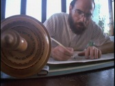 A Jewish scribe writes in a Torah scroll using a quill. Stock Footage