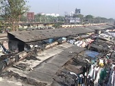 A pan across the dhobi gnats, open air laundries, in Bombay India. Stock Footage