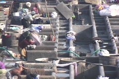 People wash clothes at the dhobi gnats, open air laundries, in Bombay India. Stock Footage