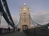 London traffic and pedestrians travel over the London Bridge. Stock Footage