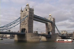 A ferry boat passes under the London Tower Bridge in London, England. Stock Footage