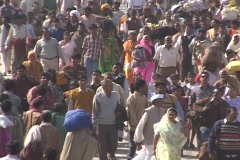 Huge crowds of people walk on the road in India. - stock footage