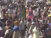 Huge crowds of people walk on the road in India. Stock Footage