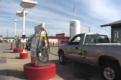 A truck fills up at the gas pump. Stock Footage